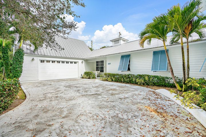 Excellent value for this 5 bedroom pool home in the heart of Jupiter.   Sims Cay has a community boat ramp and only $400/year HOA fees!  Home has large master bedroom and 2 guest bedrooms downstairs.  Two upstairs wings, one with 2 guest beds and bathroom, other with a large loft area.  Newly painted exterior and privacy fence installed 2020.   You'll love the peaceful backyard area with putting green and bar area.   Pool has a spa but no heater is present.   Two zoned AC's 2019 & 2020, two water heaters one is 2020.  Some windows are impact glass.  Metal roof approx 2006.