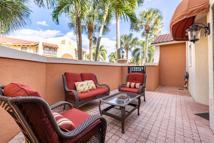 DO NOT MISS this beach town getaway in Juno Beach! This corner townhome is beautiful, move-in ready and mint condition! Featuring 2 bedrooms, 2.5 baths, single car garage and over 1,400 SQFT of living space. Updated kitchen and baths throughout. There's a private front patio at the entrance to the home to relax as well.This unit is hurricane-ready, outfitted with all IMPACT WINDOWS AND DOORS. The central AC unit is 11 years old, water heater 11 years old and the roof is 12 years old, all in excellent condition.Excellent Juno Beach location at just a 7 minute drive to the beach. Biking distance to shopping and restaurants. Within minutes to i95 and Palm Beach International Airport. Uno Lago is an intimate, all-age, gated community and includes a resort style clubhouse, fitness center, and community pool. Roof maintenance is also included in your HOA dues.