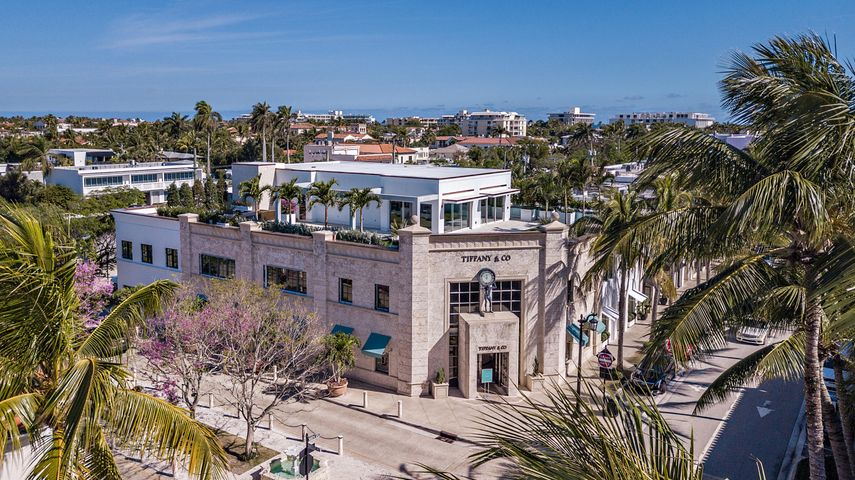 Once in a lifetime opportunity to own the only penthouse above Tiffany's on the Iconic Worth Avenue. This is the largest condominium with 13,000+/- square feet in Palm Beach and is the first property of its kind. This remarkable penthouse will comprise a unique, upscale lifestyle encompassing five bedrooms, seven and a half baths, a sumptuous master suite, maid's quarters, three fireplaces, state of the art technology, elevator and an incredible rooftop overlooking Worth Ave. The private rooftop is an extraordinary, dramatic aspect of the project. It is the only roof top of its kind in Palm Beach with panoramic views of Worth Avenue as the backdrop.The award winning, nationally recognized Design/Build firm, Kean Development Company and local architect, Keith Spina redesigned this 13,000 +/- space. Property is being sold unfinished for the new owner to customize all interior finishes over the summer of 2021.   Central to fine dining, world class fashion, and a short stroll to the ocean, its location is idyllic. This is an exceptional opportunity for a buyer to own one of the most exclusive residences on the east coast.