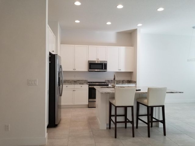 Your opportunity has arrived.  This 3 bedroom 2.5 Bath home with 2 car gar a very nice grass backyard for grilling etc. and most of all ALMOST NEW TOWNHOME WITH THE ABILITY TO WALK TO EVERYTHING.  RESTAURANTS, GROCERY, SHOPS ETC.  An opportunity doesn't come around like this very often.  The kitchen with stainless steel appliances, granite and beautiful cabinetry overlooking the great room with HURRICANE IMPACT SLIDERS out to your lovely patio.  All bedrooms are upstairs with master bedroom and private bath along with two other bedrooms and full bath. Laundry room on second level for your added convenience. There is a half bath on the main level too. Call to book your appointment now before this one is gone. ALL WINDOWS, DOORS, SLIDERS ARE ALL HURRICANE IMPACT. This community offers a pool