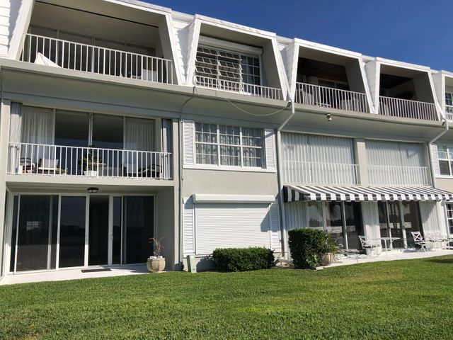 Totally renovated 2 bedroom/2bath Lanai apartment directly on the Intracoastal Waterway.Open kitchen to the living room.  Washer/Dryer in the unit. End unit in 3 story/12 apt. Villa Style Bldg. 2 parking spaces, 2 pools, Walking path, Near by tennis, golf w/Par 3 Restaurant.Ocean access, pets ok w/restrictions.