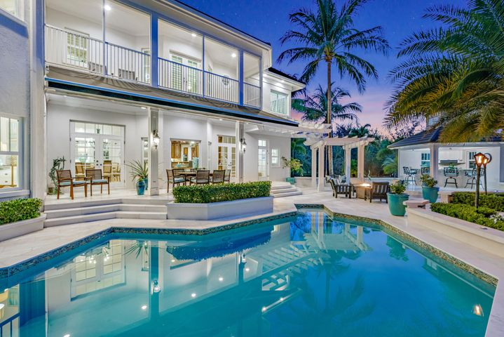 """If you're thinking ''WHOA, can this property be REAL?'', we have great news for you -- It IS real, and it is available now, just in time for Spring 2021! 8319 SE Rivers Edge is one of Jupiter's finest waterfront properties. Comprised of two spectacular residences - the 5,500 sq ft main home and 2,000 sq ft guest house - on one magnificent, sprawling 2.3 acre fully fenced & gated private property. ''Riverdance'' (as affectionately called by the original builder) was inspired by design elements found in coastal Virginia and along the Carolina coastline, and has everything you would want in your perfect home in the Palm Beaches. Riverdance features two full residences on one unique, sprawling property -- the 5,500+ sq ft main house and the 2,000+ sq ft carriage house and [Click to Read Mo   enough garage space to hold 10+ cars between the main home and carriage house. Additional exterior features on the property include a sparkling pool & spa with new pool pump & heater, and spectacular marble pool deck and patio, retractable awning, fire pit, gas tiki torches, 115 ft of manicured waterfront with 270 degrees of privacy and views, a freshly painted (premium non-slip & durable coating with 10 year warranty) dock with electric and water, a covered 16,000 lb boat lift (YES! Covered boat lift is allowed in Jupiter! Lift currently holds a beautiful 32 ft Whaler """"Vantage"""" - also for sale - contact listing team for more information), a brand new floating kayak dock, outdoor summer kitchen with new Lynx grill, and enough room to add a tennis court!  The exterior features at this property are truly endless - the current owner has cared for the home meticulously and has all kinds of fun additions throughout the property including reciprocals for holiday lights, magnificent landscape uplighting, hot water spigots for washing cars, and dozens of other features.  MAIN HOUSE:  The main house is a masterpiece of both design and function, featuring an elegantly open floor plan with bot"""
