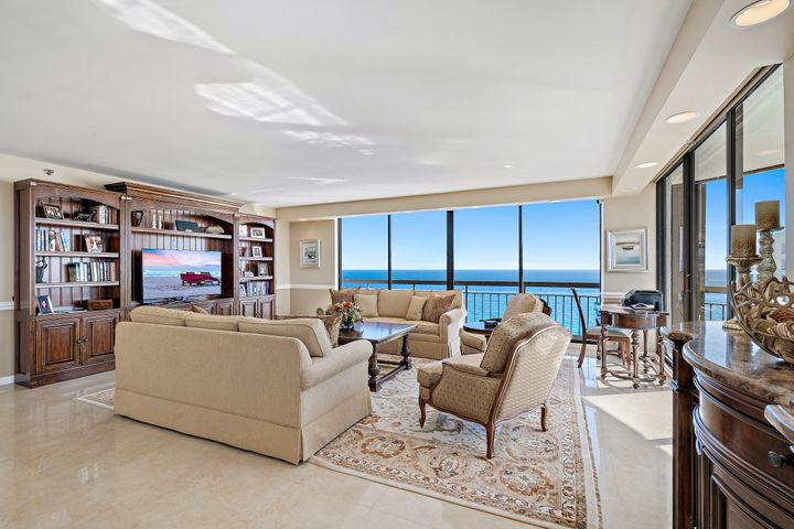 Coveted Lower Penthouse with stunning Southeastern ocean to intracoastal views in this furnished 3 bedroom at Martinique! Remodeled kitchen featuring newer cabinets, granite countertops, stainless steel appliances, and bar area. Retreat to the Master suite with balcony, two separate en-suite baths featuring dual vanities, frameless glass shower, and separate Roman tub with ocean view, bidet, and spacious walk-in closet. Two additional guest suites with updated full en-suite baths and balconies overlooking the ocean. Private nook can serve as a bonus room/office. Expansive views from all angles of this rarely available Lower Penthouse. Enjoy all the oceanfront lifestyle that full-service Martinique has to offer : 24/7 manned/gated security, lobby concierge, on-site restaurant with takeout, tennis courts, fitness centers, billiards and social rooms, library, two pools, hot tub, dog walk, on-site property management, and much more...all minutes from the best shopping, dining, and Palm Beach International Airport!