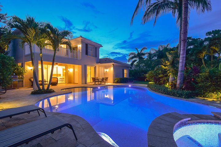 WELCOME HOME TO PARADISE! One of Abacoas Largest & Most Sought After Model Homes, Rarely Available, Oversized Corner Location with Backyard Preserve Views. 5 Bed/4Bath Pool Home with Downstairs Guest Suite. Modern Updated Kitchen with Top Notch Appliances. Separate Dining, Living & Family Rooms, + Den. Large Front Yard Porch Entry. Huge Fenced-In Backyard has a Resort-Like Pool/Spa Setting, Travertine Tile Patio Plus Covered Lanai, Perfect for Entertaining. Diagonal Marble Tile Floors Downstairs, Plank Wood Floors Upstairs. Plantation Window Treatments, Accordion Hurricane Shutters + AC Units Installed in 2018. 2 Car Garage has an Expansive Driveway and Portico. Easy Walking Distance to the Community Clubhouse, Minutes to the Beach, Restaurants, Shops & Airport, ''A'' Rated Schools. Scheduled Showings Only, Thursday, Friday, Saturday and Sunday, 12PM-5PM. All Clients/Realtors Must Wear Mask or Proper Face Coverings.