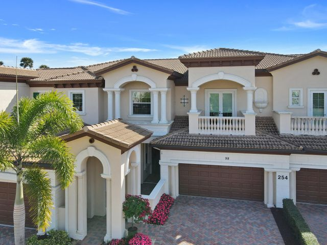 Rarely available 3 bedroom ground floor carriage home located in the community of Jupiter Country Club . This highly sought after Matera model is move-in ready and abounds with plenty of natural light. The foyer opens up to a spacious dining and great room w/ volume ceilings and upgraded crown molding. Double impact sliding glass doors lead you out to a patio overlooking the fairway.  A true chef's kitchen features top of the line stainless steel appliances, custom cabinetry, quartz counters, gas cooktop stove and  an island with plenty of storage. The private master bedroom has dual closets and an attached luxurious bathroom with dual sinks, corner tub and a separate shower. Jupiter Country Club boasts a signature Greg Norman golf course and all the amenities of a resort country club.
