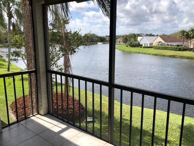 Spacious renovated 2 bed, 2 bath condo with tranquil lake and fountain views from screened porch in 24-Hour manned gated community. All new stainless appliances . Crown molding throughout, Granite counters, Marble vanities, wood and tile flooring. Washer/Dryer in-unit. Freshly painted. Private parking space with Guest spaces. Close to pool and tennis. HOA includes High Speed internet/Cable.  Moments to beautiful beaches, world class shopping/ dining. and Palm Beach International Airport. Social membership available for $750 transfer fee.