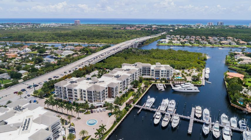 Nestled in the heart of Palm Beach Gardens is the definition of luxury in this condo with modern, transitional decor.  There are 3 sparkling, clean and comfortable en-suite bedrooms, a sophisticated great room, a kitchen defined by the floor to ceiling windows which lead to spacious balconies.  Sunrise, sunsets and spectacular full moon views define the elegant lifestyle afforded in Azure! Situated on 14 acres, boasting a marina suitable for large yachts, sailboats and outboards, this complex provides amenities to include 2 pools, walking paths, health center, putting green, storage, wine storage and much more! Join us at this opulent condominium located within walking distance to the white sandy beaches of Northern Palm Beach County. Cheers!