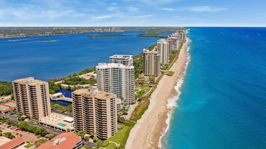 Gorgeous 2 bedroom, 2 bathroom first floor condo. Steps away to the pool and private beach! Kitchen has beautiful granite counters, glass tile back-splash, self closing drawers and newer appliances. Both bathrooms have been updated, tile throughout & crown molding throughout.  The unit has all floor to ceiling impact sliding glass doors throughout the entire condo. Plus an in suite laundry center with a full size washer & dryer. The oversized balcony with access from the living room and both bedrooms has a partial ocean view. Both bedrooms have walk in closets with built ins.  The condo is being sold furnished with a few exceptions. The community features a spacious pool deck with heated pool and gazebo, tennis courts, sauna, exercise gym, library and of course direct access to THE BEACH.. ...with miles of beach to walk searching for treasures - shells and sea glass galore!! Minutes from golfing, John D. MacArthur Park, a naturalist setting, to enjoy concerts, watch the ospreys soar, and kayak the coastal waters, Marinas for boating, and enjoy the many restaurants and outstanding shopping. GET OUT OF THE COLD....COME TO SUNNY SOUTH FLORIDA!
