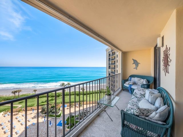 DIRECTLY ON THE BEACH in Jupiter.  Everything about this condo location is perfect - 10th floor, middle of the building, plus you get a big, unobstructed ocean view from the moment you open the front door. Ocean Trail is packed with on property amenities.  Owners enjoy an updated fitness room, secure under building garage parking, 24-hour manned guard gate, tennis and pickle ball facility, heated pool & spa, sauna, storage, and of course DIRECT beach access with miles of coastline for you to enjoy and explore.   Close to several local outdoor dining restaurants, shopping, golf, miles of walking / bike baths right outside your door, and only 30 minutes to PBI Airport.  Your oasis awaits - come make this beachfront condo your own slice of paradise in Jupiter. Click more for details..... The best view on the market in N. Palm Beach County.  Please note most feel this condo will need a full renovation.   Work can be done May - Nov and all contractors properly licensed are ok.  Ocean Trail is the only development in Jupiter directly on the beach. This building is finalizing a massive restoration project all is fully funded which includes concrete restoration, balcony refurbishment, renovated lobby and elevators, renovated storage rooms, updated fitness room and party room, new cooling tower, refurbished pool deck and landscaping.  All well managed with a strong budget and attentive management in place.