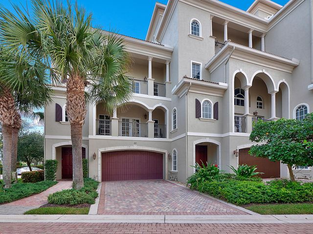 Rarely available, elegant, and beautiful townhome in Tierra Del Sol -- one of Jupiter's best-kept secrets. Newer construction, end unit situated along the prized location of Jupiter Riverwalk, Jupiter Ridge Natural Area, and one block from Jupiter Beach. Stroll along the Riverwalk to dining, shopping, and entertainment. This Mediterranean style multi-level townhome consists of 4 stories, private elevator, 3 bedrooms with ensuite bathrooms and a half bath, 2 Car Garage, rooftop terrace & private balconies for outdoor living. Wood floors, professional kitchen, natural gas, impact windows, CBS Construction. Luxurious design & superior quality, an absolute must-see!