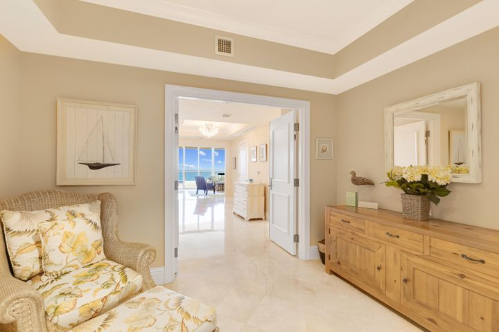 Enjoy Unparalleled Luxury and Breathtaking Oceanfront Living Combined with World-Class Amenities. Ocean's Edge is an award winning exclusive oceanfront community offering 40 spacious residences of sophisticated elegance and Palm Beach County's most spectacular panoramic views of the Atlantic Ocean and Intracoastal Waterway. Private elevator access into your own grand foyer, large floor to ceiling tinted impact windows and sliders leading out to the private terrace. Gourmet kitchen includes European Style cabinetry with under cabinet lighting, Granite countertops and backsplash, Sub-Zero Refrigerator and Freezer, Miele double oven and warming drawer, Wolf Stainless steel natural gas cooktop complete with 5 burners, pot filler, and a Thermador stainless steel ventilating hood. Wolf Microwave Asko fully integrated dishwasher, Miele stainless steel built in coffee maker, Sub-Zero wine cooler.  Marble flooring throughout all living areas.  Primary bedroom features include spacious custom built walk in closet, crown molding, slider leading to balcony.  Primary bath offers European Style Cabinets and marble countertops with his and her vanities. Separate shower and Jacuzzi 70 gallon whirlpool bath, Toto Bidet and full length mirrors. Laundry room completes this unit with large capacity Miele front loading washer and dryer, recirculating hot water heater.  Both AC units replaced in 2016. Owners can lease up to 2x per year. 45 day min and 12 month max. Additional Storage cage 3'Wx7.5'Hx5D.