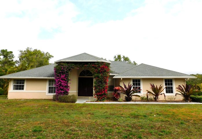 Spacious 4 bedroom , 3 bath + den/office/5th bed with screened enclosed pool and 2 car garage. House is CBS construction on 1.25 acres. Tile floor throughout. Master bedroom has  try ceiling, paddle fan and slider to lanai. Master bath has large shower and separate spa tub. A/C installed 2019