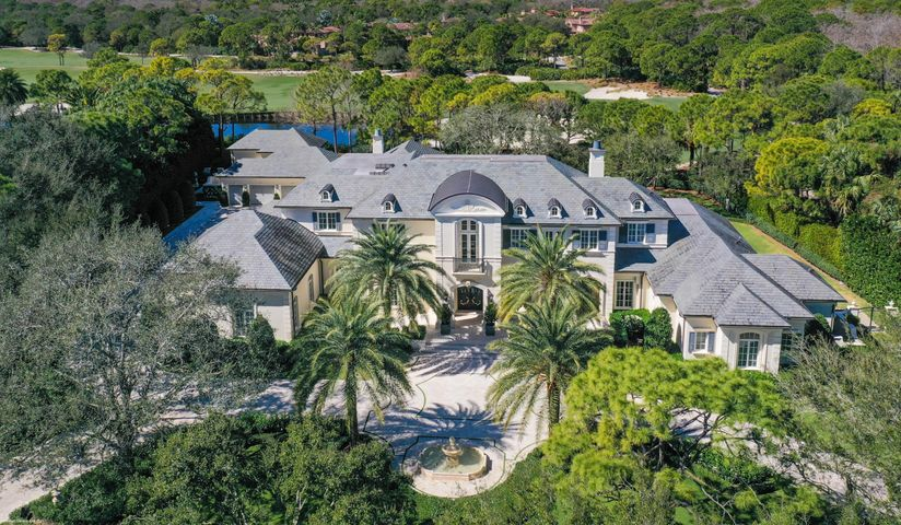 Elegant French Country estate home located on over 1.6 acres in one of the most sought over locations within The Bears Club.  This property features expansive lake and golf course views of the 13th and 14th hole of the Nicklaus Signature course at The Bears Club to the rear with views from the front facing living spaces of a largest manicured residential lake within the community. This was the first lot selected within The Bears Club community when all of the custom homesites were available.  The home was completely renovated in 2015 by Lavelle Construction and features the highest levels of fit and finish throughout.