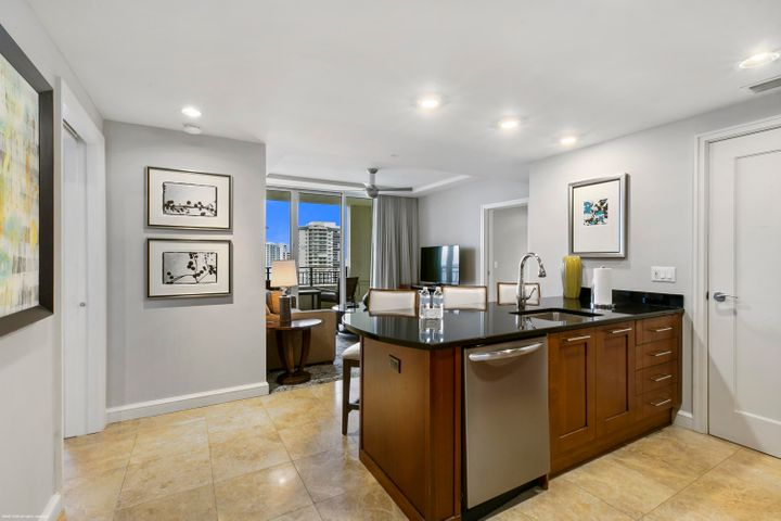 Fully furnished 2 bedroom hotel condo with excellent northern exposure overlooking Ocean Reef Park with dramatic ocean & intracoastal views. Join Marriott's optional rental program or live the resort lifestyle yourself! Combining the flexibility of ownership with the branding of the Marriott Resort hotel, this 4 diamond hotel condo gives you the best of all worlds: own oceanfront real estate; get access to luxurious hotel amenities; optional rental program; ideal corporate retreat; or perfect weekend beach house. Simply put - this is resort living at its finest. This suite is sold fully furnished. On-site hotel amenities include: white glove services; a world-class spa, kids pool, adults pool, dining options and a beach club. The Resort at Singer Island has joined The Luxury Collection as a diverse smoke-free resort. Featuring 239 all-suite resort units and 66 residential condominiums, the resort includes 4,000 square feet of meeting space, an 8,500-square foot spa, and all of the amenities and services one would expect from a world-class facility. Butler Service, valet attendants, and a full-time concierge will enrich guest experiences and activities, including coordination of private events, theater tickets, dinner reservations, and travel arrangements.  Experience the essence of elegance in one or two bedroom resort units ranging from 800 square feet to just over 2,100 square feet of living space. Decorated with dark wood tones, stainless steel kitchen appliances, and marble baths, the resort offers a luxurious contemporary modern edge. Enjoy majestic views of the Atlantic Ocean or Intracoastal Waterways from the expansive terraces in each suite.