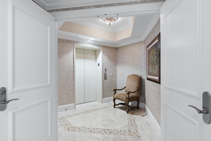 Majestic and delicately maintained 3 bedroom, 3 and a half bath condo in one of the best boutique buildings in prestige Singer Island, Ocean's Edge.  Welcome to your own piece of paradise.  Upon arrival, your private Elevator entry welcomes you to a boasting 2800+ square feet of vacation-living oasis.  Complete with an upgraded kitchen, luxurious marble flooring, spacious custom closets, and nearly 600 additional square feet of balcony space, you are sure to fall in love with this unique unit.  The serene west side fountain is sure to soothe you as you enjoy the setting sun, while the crashing of the ocean waves resonates in the background of your morning coffee. Enjoy the recently remodeled amenities including a clubroom with private dining and chef's kitchen. Top of the line Fitness Center, with dry sauna, overlooking the pool and Jacuzzi, 2 outdoor grilling areas, and an indoor movie theater.  Nothing speaks service like the staff of the building's concierge, as well as the 24 hour manned gate and security.  Experience luxury the way it was meant to be lived, here at Ocean's Edge.  Welcome home.