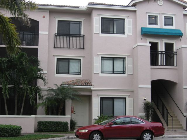 Location, location, location.  Within walking distance to the Gardens Mall.  Beautiful 2 bedroom 2 bath unit, wood floors in Dining and living areas.  Security system.  Large bedrooms, huge walk in closet in Master.  Bright workable kitchen, large screened in balcony.  Separate locked storage room for beach chairs, luggage etc.  Beautiful pool area.  Clubhouse, sauna, tennis courts and more.  Cloe to the best beaches in So. Florida, great restaurant selection close by.  A mile from #95 and minutes to turnpike.  A MUST SEE