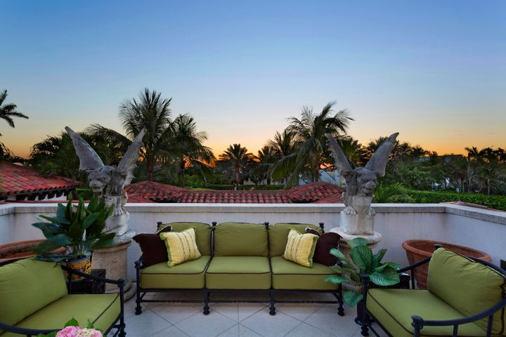 Billionaire's Row ocean to lake block Mizner estate with deeded beach access. Ensconced on a spacious 3/4 acre property with 30' hedges. Pool pavilion with soaring 18' ceilings open to new 60' infinity pool above new sunken clay tech tennis court. New York Townhouse style living in three floors, gracious central staircase, elevator. Grand Mizner wood paneled Great Room, 14' pecky cypress ceilings and original Mizner fireplace, with French doors opening to 30' outdoor terrace overlooking Intracoastal. Third floor Master suite, unobstructed breathtaking Intracoastal views 50' above sea level; separate his, her baths, multiple walk in closets.  See supplement for more. Winner of the prestigious Ballinger Award, this completely rebuilt home features high ceilings, all modern conveniences: hurricane impact windows/doors, generator. Convenient to all private schools in the area.  Ready for immediate occupancy.  DISCLAIMER: Information published or otherwise provided by the listing company and its representatives including but not limited to prices, measurements, square footages, lot sizes, calculations and statistics are deemed reliable but are not guaranteed and are subject to errors, omissions or changes without notice. All such information should be independently verified by any prospective purchaser or seller. Parties should perform their own due diligence to verify such information prior to a sale or listing. Listing company expressly disclaims any warranty or representation regarding such information. Prices published are either list price, sold price, and/or last asking price. The listing company participates in the Multiple Listing Service and IDX. The properties published as listed and sold are not necessarily exclusive to listing company and may be listed or have sold with other members of the Multiple Listing Service. Transactions where listing company represented both buyers and sellers are calculated as two sales. The listing company's marketplace is all of t