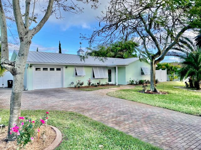 LOCATION!! MOVE IN READY!!  Meticulously maintained home located in Jupiter's highly desired neighborhood bordering The Village of Tequesta. 2 bedroom. 2 bathroom. CBS block. Newer metal roof. Updated AC & duct work. Brick paver driveway. Tankless hot water heater. Hurricane protection complete. Kraftmaid hardwood cabinetry in kitchen, bathrooms & laundry. Top of the line Viking Appliances in kitchen. Gas range/oven. Complete gated privacy PVC  fence. Room for boat/RV. Located on a quiet street.