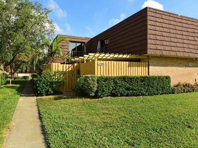 Highly desireable  Divosta Quad in Garden Lakes .  Walking distance to Publix Plaza with dinning & shopping. Updated Kitchen & bathrooms, tiled living area & wood flooring on 2nd floor.  Large master suite with walk-in closest.  Fenced lanai area privacing & plenty of room for  entertaining and grilling.    NO TRUCKS, NO SMOKING & NO PETS
