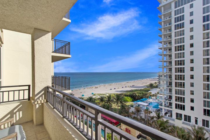 "Fabulous oceanfront luxury resort living with all of the amenities without the high price! 2 bedroom, 2 bath, 1,234 s.f. oceanfront suite with sunny Southeastern views (closest unit to ocean!). Wonderful family/pet friendly vacation retreat, relaxing & rejuvenating getaway or investment property on beautiful and unique Singer Island. Eligible for the hotel's optional owner's rental program. Featuring 239 all-suite resort units and 66 residential condominiums, the resort includes 4,000 square feet of meeting space, an 8,500-square foot spa, and all of the amenities and services one would expect from a world-class facility. Simply put - this is resort living at its finest. The hotel condo residence has recently become very popular because it offers a multitude of uses - it can be a family ""place on the beach,"" a personal time retreat from a busy life or a getaway destination that can be used as a corporate benefit. Butler Service, valet attendants, and a full-time concierge will enrich guest experiences and activities, including coordination of private events, theater tickets, dinner reservations, and travel arrangements.  Experience the essence of elegance in one or two bedroom resort units ranging from 800 square feet to just over 2,100 square feet of living space. Decorated with dark wood tones, stainless steel kitchen appliances, and marble baths, the resort offers a luxurious contemporary modern edge. Enjoy majestic views of the Atlantic Ocean or Intracoastal Waterways from the expansive terraces in each suite. Dining options include an alfresco ambiance at the ocean side eatery, the convenience of room service, or special events catered within the stunning entertainment veranda. Even a temperature-controlled wine room is available to store private wine collections.  The white sands of Singer Island provide the ultimate place to relax. Attentive pool and beach side attendants provide everything from plush beach towels and relaxing lounge chairs to tempting frozen libations. Outdoor private cabanas are the ideal place to enjoy a casual poolside lunch."