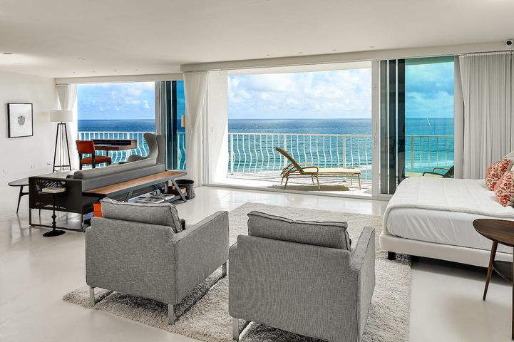 One of a kind. This unit is floor to ceiling glass and all ocean and sky as you walk in. The unit is in the process of being restored to a two bedroom unit and the positioning of the additional bedroom is such that it does not block the spectacular ocean view that runs the length of the unit. The bedroom addition is a work in progress. Currently only one bedroom is in tact.This is a must see. Ask about remaining assessments. All information deemed to be accurate but should be verified prior to purchase as errors can occur.
