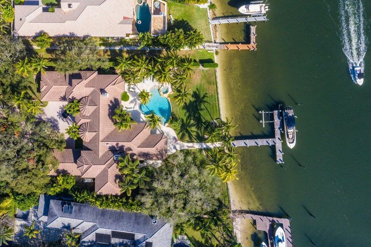 Absolutely one of a kind! ''Wilsee Retreat'' now presented for the first time in 20 years! Rare opportunity to own an established piece of real estate in the heart of Palm Beach Gardens. Situated perfectly on this high ground 1.04 acre + lot, this sprawling ranch estate has been completely redesigned giving it a 2021 new construction feel. Mature meticulously maintained oak trees surround this incredible waterfront oasis coupling spacious green views with an eastern exposure optimal breeze. Direct intracoastal action on high and wide 180 ft of rarely seen deep water intracoastal frontage. Marble floors, designer chandeliers, state of the art chefs kitchen, and 25ft soaring ceilings all combine elegance, comfort, and luxury at 2270 Wilsee Rd. Resort style backyard pool & spa, turf grass, coconut palms summer kitchen, and outdoor living all create an incredible spacious atmosphere rarely found in direct intracoastal living. Impact windows, 4 car garage with 4 car lifts (8 total), updated floors, bathrooms, kitchen, and more. House is a must see!