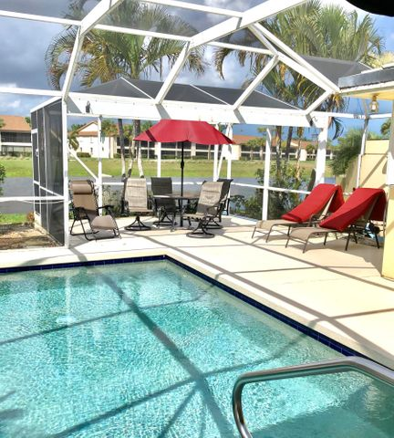 Don't miss out on one of the last affordable Divosta neighborhoods in Jupiter.  This lovely furnished Divosta Capris Extended Model rarely comes up for sale. Fabulous views of the golf course and lake outside your extended screened in patio and pool. House comes furnished with full hurricane accordion shutter protection. Community has tennis, pickle ball and community pool included in your low HOA fee. This lovely tree lined neighborhood is walking distance to the newly renovated Golf Club of Jupiter and Restaurant open to the public 7 days a week.  4 miles to our beautiful Jupiter Beaches and Parks. , Minutes from shopping, restaurants,  Abacoa, Entertainment and 25 minutes to PBI Airport.  GREAT LOCATION- Call Listing agents for your private showing. Due to Covid Mask are required!