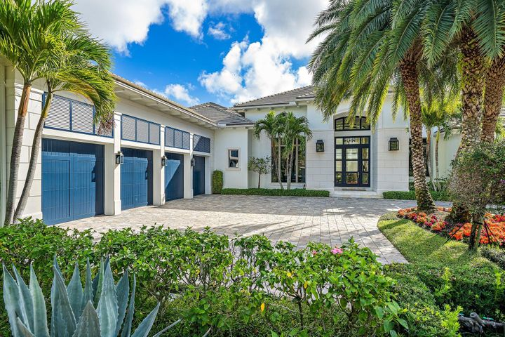 Beautiful Custom British West Indies style home in the desirable Grand Estates in Old Palm Golf Club. Spectacular panoramic views of the 9th & 18th fairways, pond & clubhouse. Marble and wood flooring throughout. Gourmet kitchen, 2 Wolf wall ovens & 6 burner gas range w/2 ovens, pantry & butlers pantry. Spacious 1st floor master bedroom w/dual bathrooms & closets. Handsome office w/built-in cabinets looking out to the swimming pool & spa. Casual & formal living areas. Covered loggia off the living room w/full summer kitchen & electronic screens is perfect for outdoor entertaining. 2 guest suites up stairs w/loft area/game room and electric screened balcony. This light & bright home offers floor to ceiling windows & over 600sf of walk in a/c storage space. 4-car garage. Don't miss this one! There are no tee times to play on this pristine signature Raymond Floyd designed course. A separate 3 hole practice studio with Trackman V-1 swing analysis makes Old Palm Golf Club the perfect golf haven for the avid golfer or beginner. Club house features fine dining, lounge, men's and women's spa, fitness center, pool with cabanas, one bedroom casitas for rent. Membership includes beach membership at the Palm Beach Hilton on Singer Island, mins to the beach and popular restaurants along the PGA corridor, Palm Beach and Jupiter.