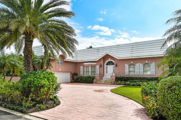 This Northend one story, split level residence is being sold ''As Is, Where Is''. The Lot Square Feet is 12,632 +/-, Lot dimensions 100 +/- by 122+/-, living area 3,907 +/- and total square feet 4,436+/- as reported by Palm Beach County Property Appraisers. The house is total square feet of 4,379 +/- and living square feet of 3,866 +/- as measured by the Floor Plan Professional. There is platted beach access governed by an Association. The pool is believed to be filled in for the patio. The roof is flat bordered by a mansard style. There are 2 air conditioning zones.