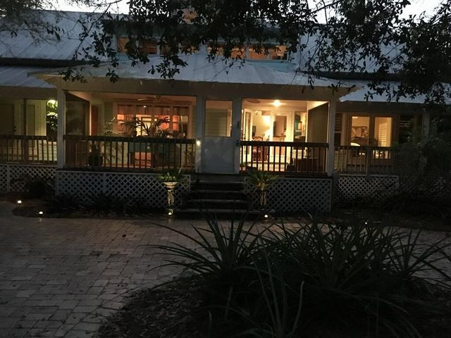 One of the most majestic homes you will find in Jupiter Farms. Southern plantation home with a full 360 degree wrap around screened porches. Vaulted ceilings throughout the home. Spacious bedrooms with master suite made for royalty. Open kitchen to family room for entertaining a crowd. Bonus storage everywhere including a huge walk in attic. Four bedrooms, split plan all separated for privacy. Second floor has another bedroom/bathroom with a large loft office space. Detached two car garage with high ceilings. RV Carport in back for lots of possible uses. Hardi-plank siding, custom home built by the owner. Peace and serenity a plenty in this spectacular piece of paradise.