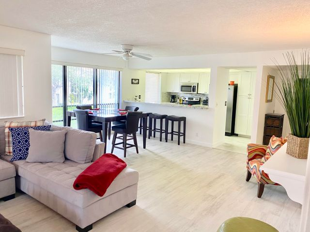 Beautiful, bright & open floor plan fully furnished. 2 bedroom,2 bath. This home has been updated with new designer tile floors. New kitchen with gorgeous cabinets, granite counters, farm sink, stainless appliances, remodeled bathrooms with upgraded vanities & granite countertops, luxurious shower with seamless glass doors, master dressing room. This unit boasts expansive wrap around screened in balcony, surrounded by magnificent oaks & just a few steps away from the heated pool. Experience PGA National Resort living in the Golf Villas Community. This corner unit, usually the first to be snapped up is on the second story located in the heart of PGA National home of the Honda Classic. Close to an array of different restaurants & Florida's pristine beaches.