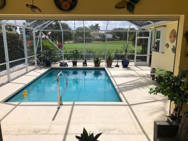 Indian Creek community has very few properties for sale as it is one of the most sought after communities in Jupiter.  The community has many mature green trees, safe and very relaxing to live in. This beautiful DiVosta Capri villa sits on the Jupiter Country Club golf course, has a heated pool with screened deck, impact glass and accordion shutters, with the patio having electric roll up shutters. Floor plan is open with 2 separated bedrooms and 2 full baths. Residence has a 2 car garage with parking for 2 cars in driveway.       House is being shown fully furnished with Yum Yum Tree furniture, quartz counter tops and includes all stainless steel appliances with washer, dryer and central vac.  Roof  maintained by HOA, updated, no assessments, Air unit new York in 2018.