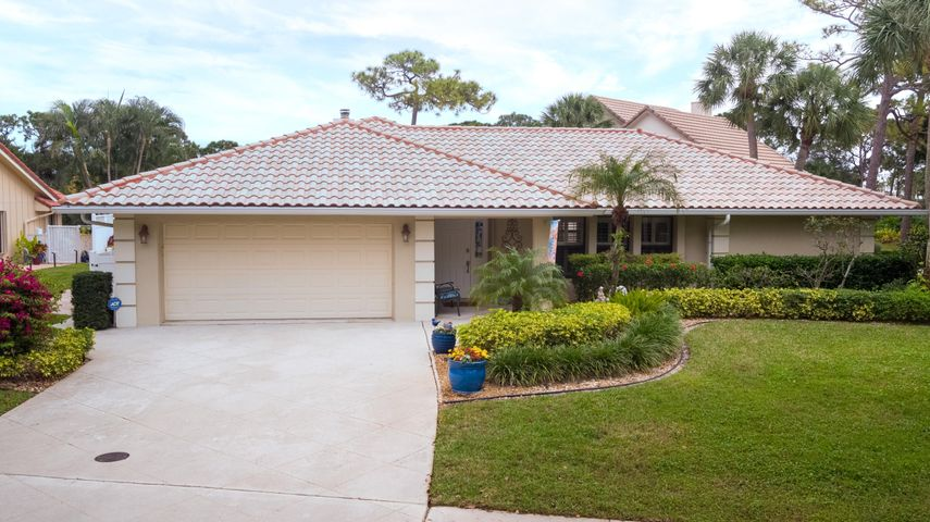Welcome home to this beautiful, updated 3 bedroom/2 bath located in The Shores of Jupiter. The kitchen has been upgraded with quartz counters and backsplash, large island & stainless steel appliances. Plantation shutters throughout the house along with Hunter Douglas motorized shades in the family room.  The family room also host vaulted ceilings and wood burning fireplace. There is an underground natural gas tank that feeds the new pool heater and the outside grill.  As mentioned, the resort style pool, which is salt water, is heated by either a gas heater or solar panels to give you the most efficient options to heat your pool in the cool months.  The outside decking is a Kool Deck surface along with a speaking system for your entertainment needs. The Shores is a low HOA community that is conveniently located just east of 95, close to all of the fine dining that Jupiter has to offer, a few miles west of the Atlantic Ocean and just a bike ride to Jupiter's A rated elementary school.