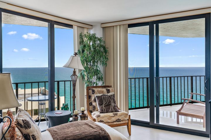 Amazing high floor panoramic views of the Atlantic Ocean, Intracoastal Waterway and estuary islands of MacArthur State park. This totally renovated condo offers all hurricane impact glass sliding doors, 24X24 travertine flooring and split bedroom floor plan. The kitchen has beautiful custom wood cabinetry, granite counters and a stainless appliance package. Both bathrooms were renovated with new vanities, fixtures and shower walls. Comes with garage parking. Amenities include, lush landscaped beach side heated pool, outside grill area, his/her sauna, owner's lounge with kitchen, gym and three tennis courts.  The Managers office is on site with a concierge till midnight daily; extra storage secured building entry and covered parking. All impact windows and doors