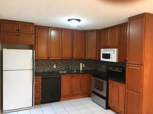 Downstairs den has a door and can be used as a 3rd bedroom. NEW central a/c system. electric water heater and dryer. Very private location