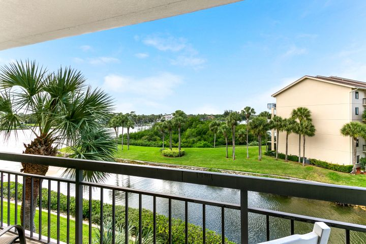 Fully upgraded Bluffs Marina condo with beautiful Intracoastal view!  No expense spared in this fourth-floor end unit including a bonus/laundry room, ideal for storage, home office or guest room.  Pool area has a covered pavilion and stunning views of the Intracoastal. Picnic area, tennis courts and beautiful tropical landscaping with winding sidewalks throughout the complex. Perfect for walking or a safe off-street bike ride. Conveniently located less than a mile from the beach and 20 minutes to Palm Beach International Airport and downtown West Palm Beach. Plenty of shopping and restaurants nearby.