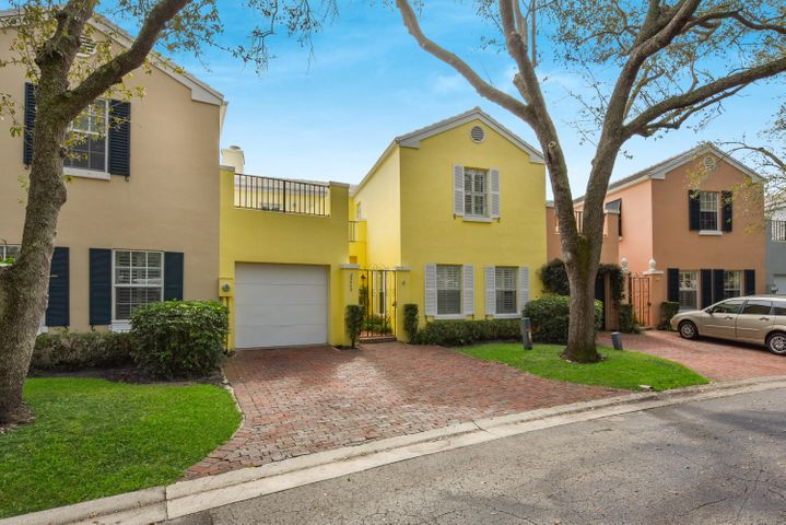 Rarely Available! This charming townhome is located in a premier location in the award winning community of Charleston Place.  Situated across from the large park which is surrounded by arched bougainvillea walkways. Live Oak Trees form a canopy over the streets providing comfort from the heat. 5 year old roof, new A/C, french doors, porcelain tile floors and  wood burning fireplace are only some of the features. 105 units and 4 swimming pools.  Like no other community in Boca Raton.