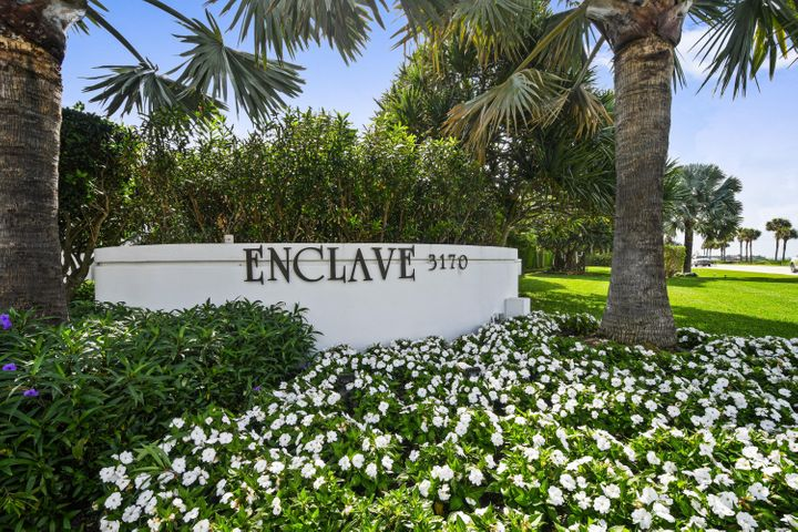 Chic elegance in this ocean view condo in highly sought-after Enclave of Palm Beach. Featuring 2 master suites and 2.5 baths. A grand foyer entry truly makes this space feel like home. An open living space is elevated by the custom built-ins and overlooks the ocean. Perfect for effortless entertainment, the living area flows into the formal dining room with built in bar. Never miss a sunrise or sunset from the spacious wrap around balcony with views of both ocean and intracoastal. Hurricane Impact doors plus accordian shutters. The guest bedroom has it's own walk in closet and ensuite bath. The grand master suite has ocean views, custom walk-in closets and a spa-style bath.Located in the south building of the Enclave, you will have natural sunlight from dusk until dawn. These boutique buildings offer only 36 residences each. Full concierge services and top-notch amenities are provided at the Enclave such as 24 hour manned gate, front desk attendant and doorman, 2 har-tru tennis courts, resort-style pool, garage parking and newly designed fitness center. Water heater and AC are 2015, Refrigerator is 2020- move-in ready!