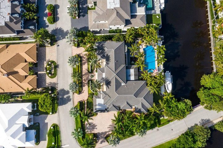 This exrodinary property sits on almost 1.5 lots (25,887 Sq. Ft.) in Royal Palm Yacht & Country Club, one of the most prestigious neighborhoods in South Florida. Now is the perfect time to come build your DREAM ESTATE with approximately 145 Ft. on the Butterfly Palm Waterway.