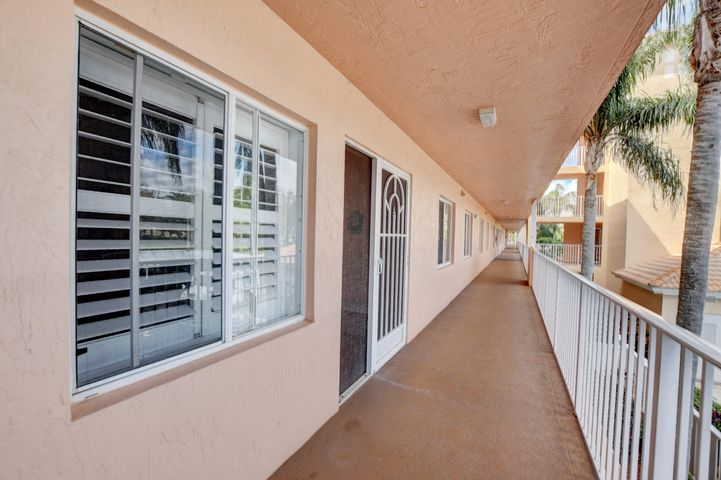 Stunning lake view, 2nd floor with elevator. This unit comes 100% FULLY FURNISHED. There is also an assigned, covered car port for the new owner of the unit. There is clean, white, bright tile floor throughout the entire unit. The entire unit was recently painted. The kitchen has a breakfast nook with a table and 2 chairs to sit at and enjoy your breakfast and coffee.Patio converted into Living space with stunning lake views.The window has Plantation shutters and there is an extra larger pantry to store all your can goods in. LG fridge, stove, microwave, garbage disposal. All appliances are in amazing condition. The den area has a built-in entertainment center with a TV already installed for you. Across the hall is a separate room with the washer, dryer, electrical box and a slop sink.  The 2nd bathroom has a tub/shower combo with glass sliding doors and right outside of the bathroom is a linen closet.. The master bathroom has a vanity with double sinks, a jacuzzi tub and walk in shower.  The community of Regal Shores, has an unmanned gate to get into the community and another security box to get into the building. There is an elevator and sitting area inside the lobby. The unit comes also with extra storage space And maybe rented right away  Coral Lakes in Boynton Beach is comprised of both gated and non-gated subdivisions within the over 580 acres of lovely landscaped grounds. This is truly an active adult community, designed for the those who want to be busy throughout the day. This lovely community offers a full complement of amenities for every personality. There are ample grocery stores, shopping and dining choices for every budget and taste. The community is within a short drive to the fabulous Atlantic Avenue in historic downtown Delray with its fabulous restaurants, artsy little cafes and bistros, art galleries and unique boutiques. There is also easy access to the miles of pristine beaches.  Just some of the amenities offered to residents of Coral Lakes are: * Fabulous 72,000 square foot community clubhouse * Resort styled outdoor community pool * Indoor heated swimming pool * Well Equipped Fitness Facility * Tennis Courts * Billiards *Library * Arts/Ceramics studio * Ping Pong * Library * Computer Room * Cafe for breakfast and lunch and much more....