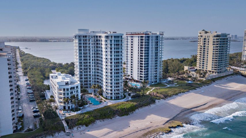Incredible 11th floor luxury residence in the Beach Front by Toll Brothers with some of the best views in the building!  Direct east ocean facing with 270 degree panoramic views from 4 expansive balconies, enjoy the sunrise and sunsets from this gorgeous condo with private elevator and only 3 condos per floor.  This residence has a  coveted large open layout floorplan which includes a large custom designer kitchen and appliances, beautiful granite countertops, 2 kitchen seating areas, marble floors, and 9 ft. tall impact glass windows throughout. Numerous building amenities include 2 barbecue areas, a fitness center with sauna and 2 locker rooms, a social room with wet bar and kitchen, a card table area, billiards area, theatre room, dog run, beautiful landscaping, concierge, and more.