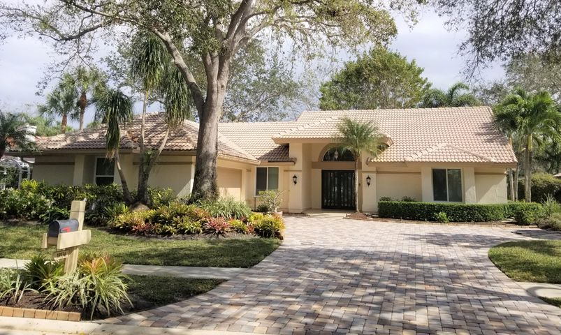 NO SHOWINGS UNTIL AFTER OPEN HOUSE SUNDAY  FEBRUARY 28 FROM 1-4 PM  Updated and spacious Rutenberg built CBS home on the lake in The Shores of Jupiter. Featuring 3bd, 2ba, split floor plan, home office, and an expansive great room with lake views. Newly renovated kitchen, new kitchen cabinets, quartz countertops, SS appliances, new 12 mm laminate water proof and stain resistant flooring throughout. Total impact windows, impact front door, 2 car garage. ADA modified with many upgrades! Beautifully landscaped with a paver driveway and a charming paver patio overlooking peaceful water views. Just minutes to Florida's beautiful Atlantic Ocean beaches,  dining, shopping, I-95, and the turnpike. If you want to go back in time to a laidback peaceful lifestyle, this home welcomes you. This home is ADA compliant and offers A rated schools. This home will not disappoint and will sell quickly!