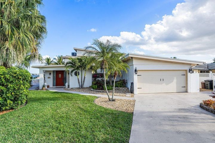 DON'T MISS OUT ON OPEN HOUSE THIS SUNDAY, FEBRUARY 28 FROM 1-3PM! Boaters Paradise... 81ft on water w/ stunning wide water views from this 2 story, 4bd, 3 ba (1/2 ba shower only), 2 car garage, pool home in Stuart. This home features master suite downstairs, w/ large master bath, w/ jacuzzi tub, dual sink, & separate shower. Also features family room w/ gorgeous wood burning fireplace, formal dining room, den/ Florida room overlooking pool, & wide water. Updated galley kitchen leads to large utility room, dry sauna, & steam shower. Upstairs features 2bdrms, full bath, office, family room, and sun deck w/ jacuzzi all w/ gorgeous water views. FYI upstairs could easily be converted into mother-in-law suite w/ kitchen.