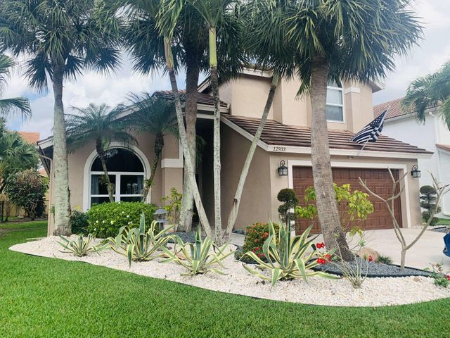 This immaculate and beautifully updated home is available in the desirable Boca Winds community. This home features a split floor plan with 4 bedrooms, 2.5 bath and a 2-car garage. Enjoy your lake view from the gorgeous patio with a beautiful pool and outdoor space. The open floor plan provides ample space for families and entertainment. Kitchen is upgraded with wood cabinets, granite countertops, and stainless-steel appliances. This home has tile floors downstairs, laminate flooring upstairs, and accent walls throughout. The master bedroom is on main floor.   The entire house is storm protected. It has all IMPACT windows, sliding glass doors, hurricane proof garage and stunning front door. This stunning home is turn key and move in ready.