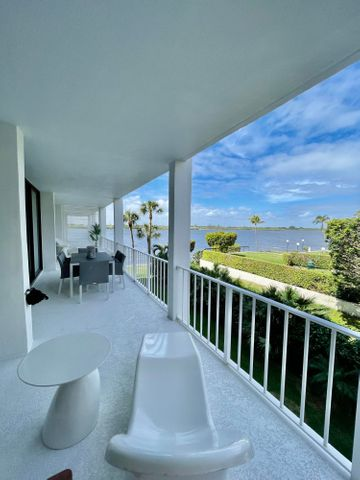 Experience waterfront boutique living in the desirable Cove Condominium. This completely renovated 2 bed-2 bath offers expansive one-of-a-kind views of the intracoastal, each bedroom has access to a 40 foot terrace. Impact Hurricane glass sliders throughout. Also includes a fully renovated Cabana by the pool. 2 Assigned parking spots, and includes 3 storage units.  Amenities incl. fitness room, Doorman, Sauna, Club room, and more. Directly across from the newly renovated Four Seasons Hotel. Deeded beach access for The Cove residents Minutes away from Worth Avenue, Palm Beach airport, and the Palm Beach Par 3 Golf Course. Furnishings negotiable