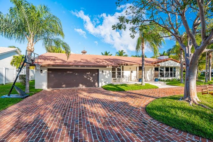 9 Gatehouse Road, Sea Ranch Lakes, FL 33308