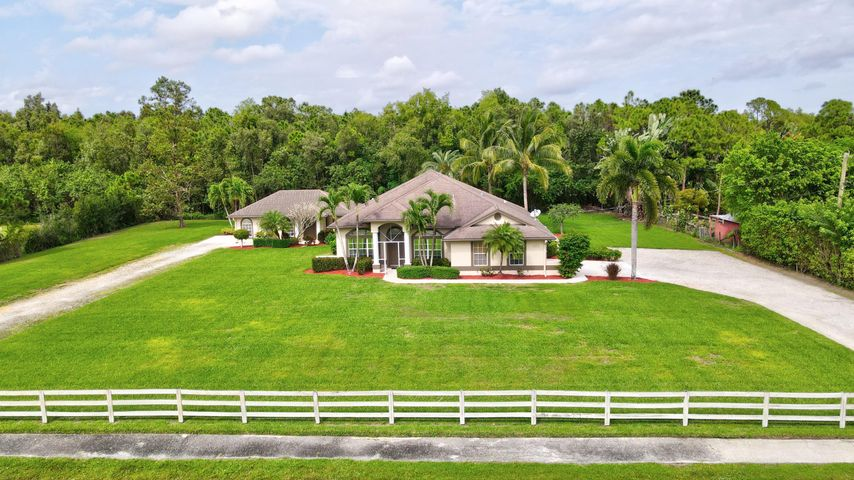 Sitting on a massive 1.19 acres in WPB is sublime!