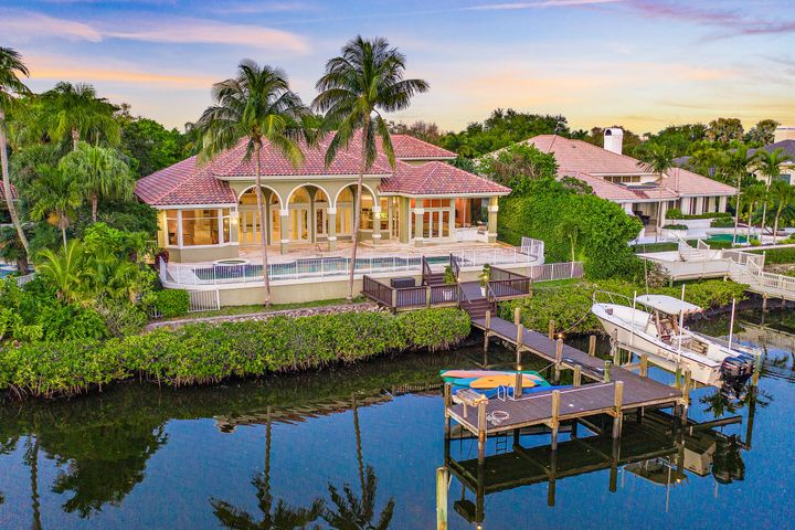 This stunning Custom South facing home with RARE TENNIS MEMBERSHIP, in much sought after Admirals Cove, is situated on 100 feet of water frontage for up to 70' boat.  6 bedrooms, two offices, open kitchen to the main floor family room, a formal living room and formal dining room, exercise room and enormous play room. Wide open floor plan, light, bright, and water views!  White contemporary finishes, blended with some traditional textures. New roof, new garage doors, fireplace, generator, etc. Meticulously maintained by original owner. Amazing opportunity - this won't last.