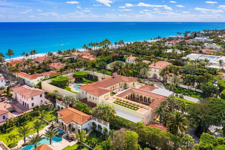 Totally reimagined compound situated on over one acre of land in the heart of the Estate Section. At over 23,000 total square feet, 151 Via Bellaria is one of the largest homes in Palm Beach & is unlike anything else currently being offered for sale on the Island. The home's main living spaces are centered around the most striking courtyard, which is perfectly suited for large scale outdoor entertaining or casual relaxation alike. 14' ceilings on both the first & second floors add to the homes impressive sense of scale & grandeur. The master suite overlooks the manicured gardens & swimming pool & is perfectly appointed with dual bathrooms & ample closet space.  Other features include a full home generator, a brand new roof, a 4 car garage, a motor court, staff quarters & keyed Ocean access