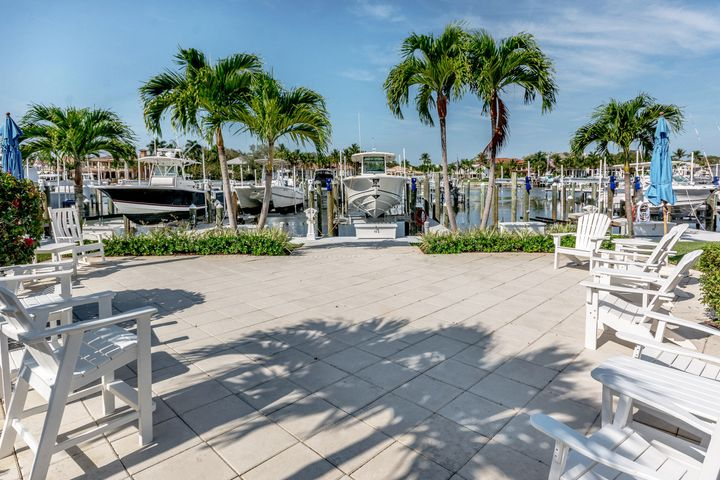 Beautiful, large 2/2 in boater's paradise Bay Colony. This unit has many upgrades, all Bosche kitchen appliances, soft close cabinets, with pullout shelving and generous storage throughout.  The Master Suite has 2 closets with built ins - one a large walk in closet; the Master Bath has two vanities separate glassed shower and a soaking tub. The second bedroom also has a sizeable walk in closet. There is a laundry room in the unit with ample storage... and an air conditioned storage unit in the building.  With a great location in the development the 10'' x 16' patio looks out on to lovely green open space and near the Resort style amenities - pool, fire pit and more. This unit is just steps away to the private marina and lovely sunset views over the Intra-Coastal.